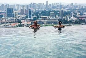 TACTIC: Tourist Emma Balmforth took bathrobes and slippers from a housekeeping cart to pass off as a hotel guest at Marina Bay Sands.