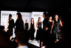 PARADE:The Miss Universe Singapore 2016 finalists walk the runway at the Amber Lounge F1 Driver Fashion Show in outfits by local designer Max Tan.