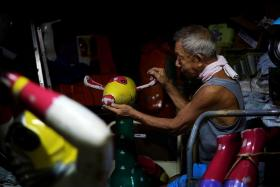 PASSIONATE: Mr Lee Kim Leng said his 'love affair' with kiddy rides began in 1979, when he first saw someone working on one. He does not intend to pass down the business, but he continues to do repair and supply rides out of personal interest.
