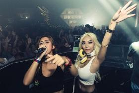 AT WORK: Leng Yein (with blonde hair) and Leng Sean were in Singapore over the weekend and performed at FashionTV Club's Pitstop Party (above).