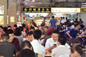 CROWDED: Following the initial Zika virus scare, diners have returned to Sims Vista Market and Food Centre (top) and Geylang East Centre and Food Corner.
