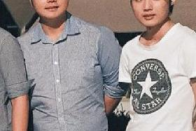 BROTHERS: Ng Yao Wei (above, right) stabbed his brother Ng Yao Cheng (left) 22 times, including seven times in the neck.