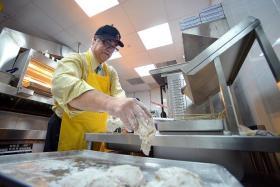 HANDS ON: Texas Chicken CEO Jim Hyatt preparing the fast-food restaurant's signature fried chicken.