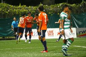 NUDGING AHEAD: Albirex Niigata's (in orange) win over Geylang International (in stripes) last night gives the White Swans a seven-point lead over second-placed Tampines, with four games left.