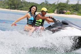 BINTAN BASH: Cheryl Chou, 20, had her bikini photo shoot done on a jet ski.