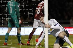 BROUGHT TO HIS KNEES: Wayne Rooney rues yet another missed opportunity in the League Cup clash against Northampton.