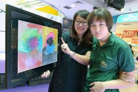 PASSION: Alexandra Ming, 15, and her mother, Mrs Marian Main, 56, with her winning entry Free To Express.