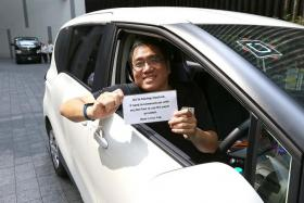 DEAF NOTE: UberX driver Roland Goh holding up a sign for his passengers that tells them he is hard of hearing.