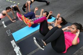 FEELING THE BURN: (From right) Finalists Nutan Rai, Patricia Eng and Joeypink Lai at the circuit training group session conducted by Bodyburn Fitness.