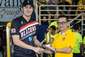 """""""I'm very honoured to win the individual award, but I had to make the most blocks because I'm the tallest player in the league and it's what I do — defence is a big part of my game."""" - Singapore's Delvin Goh (left), who was named best block shot artist in the EBL"""