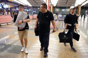 GOING HOME: (From left) Mr Byeon Dae Seung, Captain Kwon Do and Mr Kim Seon Kuk at Changi Airport.