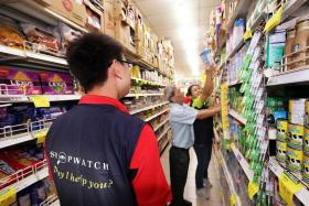 UNIFORM: A Prime Supermarket employee in a ShopWatch vest patrols the aisles as part of the ShopWatch Community Safety and Security Programme.