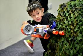 FULFILLED: Raphael Lim Zi Xun having a blast with his Nerf gun.PHOTO:  MAKE-A-WISH FOUNDATION SINGAPORE