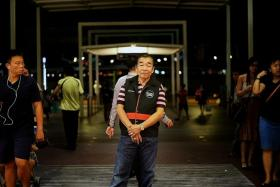 ON PATROL: Mr Andrew Yow (above) is one of NTUC FairPrice's trolley enforcement officers, and patrols around Jurong Point to ensure that no one leaves the mall with the supermarket's trolleys.