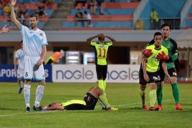 OH NO: Tampines' Sufian Anuar (on the ground), Jordan Webb (No. 11) and Hafiz Sujad (being held by DPMM's Wardun Yussof) rue a missed opportunity as DPMM's Brian McLean looks on.