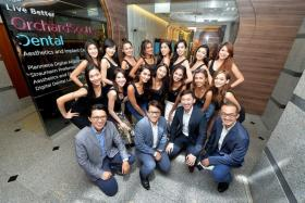 ALL SMILES: The MUS finalists at Orchard Scotts Dental. First row, from left: Dr Ronnie Tay, Dr Jerry Lim, Dr Kenneth Tan, Dr Kelvin Chua. Second row, from left: Hazel Tay, Shona Woo, Nutan Rai, Tanisha Khan, Poojaa Gill, Shanice Hedger, Nikki Tay. Third row, from left: Althea Lew, Joeypink Lai, Patricia Eng, S. Sreeveena, Sonya Branson, Luisa Gan, Cheryl Chou, Vanessa Tay