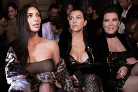 Happier times: (From left to right) Kim Kardashian, Kourtney Kardashian and Kris Jenner attending the Off-white 2017 spring/summer ready-to-wear collection fashion show in Paris on Sep 29, 2016.