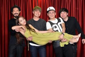MUSICAL FAMILY: Cruise Control, comprising (from far left) guitarist Lai Jee Yon, drummer Joe Lee, vocalist Andy Zhang and pianist Zach Tan, and (being carried) one of the vocalists, Miss A. J. Ying. They appeared together for the first time during Happy Hour at Clarke Quay nightclub Shanghai Dolly on Monday.