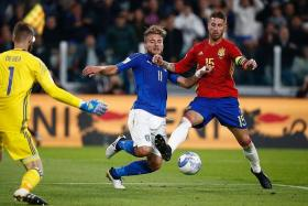 POOR FORM: Spain captain Sergio Ramos (No. 15, tackling Italy striker Ciro Immobile) has given away three penalties in just nine games for Real Madrid this season. The penalty he conceded against Italy yesterday morning makes it four.