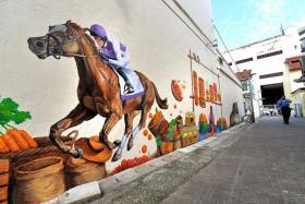 COMMUNITY COLOURS: More than 40 people worked on the 20m-long community art project, which features details from Race Course Road's history as a hub for horse racing and trading.