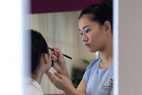 PROFESSIONAL: Miss Khloe Ng won a bronze medal in the 11th Asean Skills Competiton's beauty therapy category, which tested make-up application and manicures among other components.