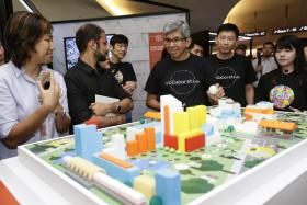 ONLINE: Minister for Communications and Information Yaacob Ibrahim and Minister of State for Ministry of Communications and Information Chee Hong Tat at the launch of GovTech yesterday.