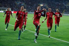 GOAL MACHINE: With his four-goal feat against Andorra, Cristiano Ronaldo (centre, No. 7) takes his Portugal career tally to 65 goals in 134 appearances.