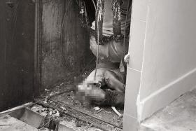GRISLY: The worker was found injured in a rubbish chute at the ground floor of Block 8, Jalan Rumah Tinggi.