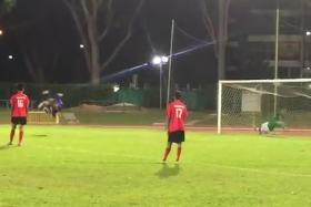 Syafiq Sazali (in blue) of Yishun Sentek Mariners scores a somersault penalty against Kaki Bukit Sports Club.