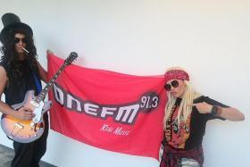 ONE FM 91.3 DJs Shan Wee (left) and Cheryl Miles dressed as members of Guns N' Roses.