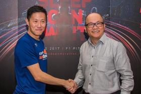 10TH EDITION: HiVelocity managing director and OSIM Sundown Marathon organiser Adrian Mok (above, left), shaking hands with CEO, founder and chairman of OSIM International Pte Ltd, Ron Sim, after revealing the event's regional expansion plans at a press briefing yesterday.