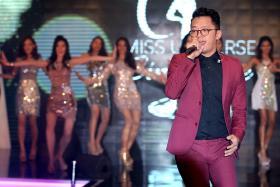 ENTERTAINMENT: Local singer-songwriter Sezairi Sezali singing as the 15 finalists danced behind him.
