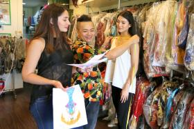 Miss Universe Singapore 2016 Cheryl Chou (far right) during a fitting with veteran costume designer Moe Kasim, accompanied by MUS national director Nuraliza Osman.
