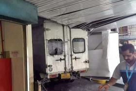 TOO BIG: The lorry allegedly exceeded the mall carpark's 2.2m height limit and got stuck.