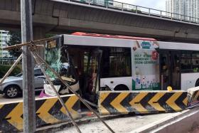 DAMAGED: An SBS bus 185 hit a temporary road divider at the junction of Clementi Road and Commonwealth Avenue West, which damaged the front of the bus.