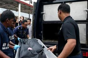 The body of the newborn, who was found in the women's toilet at Tampines MRT station, being removed.