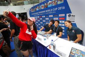 WEFIE: From far right, Japanese swimmers Kanako Watanabe, Daiya Seto and Masato Sakai take a photo with a fan.