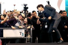 SMILE: Lee Kwang Soo posing for photos with fans at yesterday's meet-and-greet session at Changi Airport.