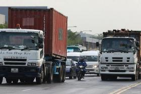 EVERYDAY TRAFFIC: A typical scene on Tuas West Road during peak hours, when it is packed with heavy vehicles and motorcycles.