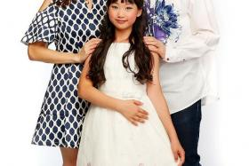 POPSTAR: Kaitlyn Ong, 10, with her parents.