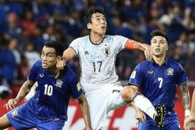 NO. 7: Charyl Chappuis (right) in action for Thailand during the 2018 World Cup qualifier against Japan in Bangkok on Sept 6.