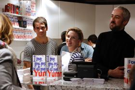 US actress Scarlett Johansson and her husband Romain Dauriac (L) attend the opening of the Yummy Pop gourmet popcorn shop in the Marais district of Paris on October 22, 2016.