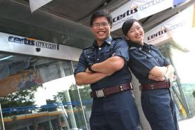 DON'T STOP LEARNING: Mr Muhammad Eirwannor and Miss Cheryl Tan are among the first cohort of auxiliary police officers in the work-study scheme. They pick up skills relevant to their careers in the training process, such as conducting security bag checks.