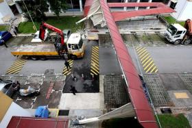 DAMAGED: The crank of a lorry crane hit a covered walkway at Bukit Batok, causing it to collapse.