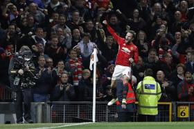 HOME JOY: The Old Trafford crowd cheering Juan Mata after he scores the winner, which piled on the misery for Man City boss Pep Guardiola.