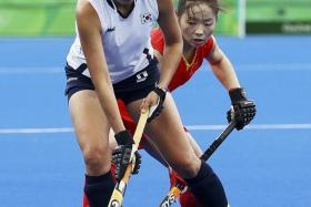 SEE YOU AT SENGKANG:South Korea and China, seen here battling to a 0-0 draw at the Rio Olympics, will meet again at the Sengkang Hockey Stadium next week.