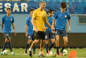 BRIGHT PROSPECT: Garena Young Lions coach Patrick Hesse (in yellow) singled out Joshua Pereira (far right) as an example of a budding talent coming through the ranks.