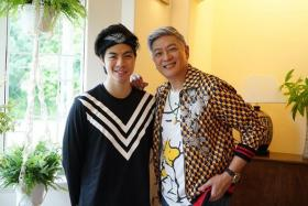 Dick Lee with local singer Benjamin Kheng, who plays him in the movie.