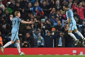 DOUBLE DELIGHT: Man City sent mighty Barcelona packing with goals from Ilkay Guendogan (right) and Kevin de Bruyne (left).