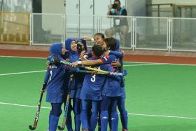 UNEXPECTED: Malaysia (above) celebrate an unlikely 2-0 win over tournament favourites Japan.